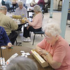 Record-Eagle/Keith King <br /> Gloria Tabone, of Traverse City, plays dominoes Thursday, February 17, 2011 at the Traverse City Senior Center.