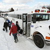 Record-Eagle/Keith King <br /> BATA buses pick up students at Suttons Bay Public Schools.
