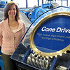 "Record-Eagle/Bill O'Brien<br /> Cone Drive's Roberta Wagner displays a demonstration unit of the company's ""worm gear"" technology that will be used in the world's largest solar thermal energy project under construction in California."