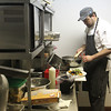 Record-Eagle/Jan-Michael Stump<br /> Chef Ryan Mateling works in the kitchen at Harbor 22.