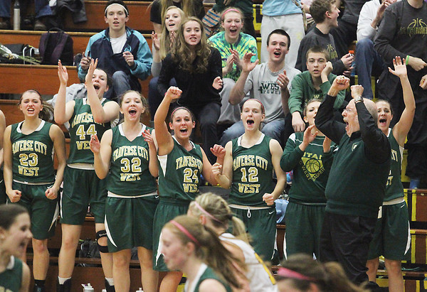 Record-Eagle/Jan-Michael Stump<br /> Traverse City West players and coach celebrate Lauren Lozowski's basket in the fourth quarter of Thursday's win at Traverse City Central.