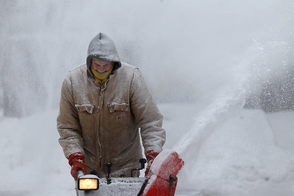 Record-Eagle/Jan-Michael Stump<br /> Mike Hanson snowblows outside his home at East Eighth and Davis Streets in Traverse City during Tuesday's snowstorm.
