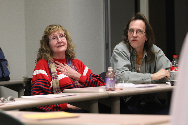 Record-Eagle/Jan-Michael Stump<br /> Deby Womble of Grayling speaks during a meeting of the Traverse City Lupus Support Group while her husband Glen Womble listens Wednesday at Munson Community Health.