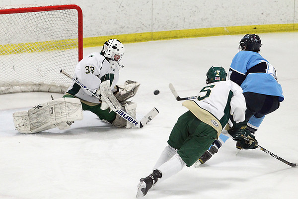 Record-Eagle/Jan-Michael Stump<br /> Traverse City West's Carter Edmondson (33) stops Petoskey's Ken Forton (11) on a break away in the second period of Wednesday's game.