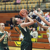 Record-Eagle/Jan-Michael Stump<br /> Traverse City West Katie Placek (11) gets the basket and draws a foul on Traverse City Central's Bianca Richards (12) in the first half of Thursday's game.