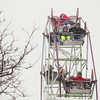 Record-Eagle/Keith King<br /> Heavy snow falls on a Ferris wheel and its riders Saturday, February 16, 2013 on Front Street during the Traverse City Winter Comedy Arts Festival.