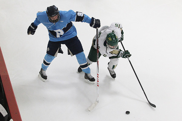 Record-Eagle/Jan-Michael Stump<br /> Traverse City West's Ashton Lawton (16) skates past Petoskey's Cam Ludlow (9) in the second period of Wednesday's game.