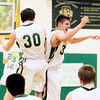 Record-Eagle/Jan-Michael Stump<br /> Traverse City West's Zach McGuire (30) and Kendrick Meyer (33) celebrate Friday's 66-54 win over Traverse City Central.