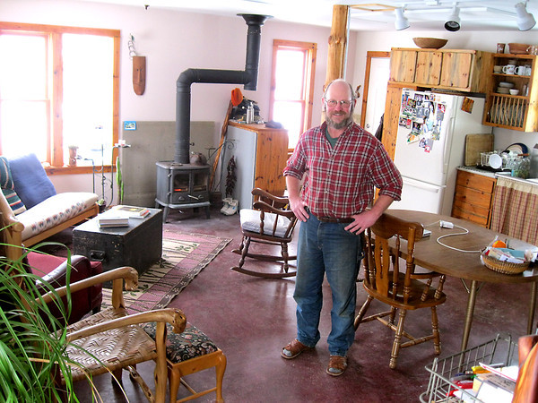 "Record-Eagle/ Anne Stanton<br /> JEFF ANDERSON<br /> Jeff Anderson's small house began life as a garage. His wife, Sandi McArthur, calls their home a ""garouse."""