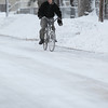 Record-Eagle/Jan-Michael Stump<br /> Andy Cuchetti rides his bike to work after several inches after fresh snow fell overnight.