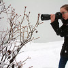 Record-Eagle/Marta Hepler Drahos<br /> Williamsburg photographer Caitlin Scroggins shoots a winter photo in Traverse City Thursday. Scroggins, 15, placed in the top 24 in the nationwide National Geographic Student Expeditions Photo Contest with her image, 'Colorful Flowers.'