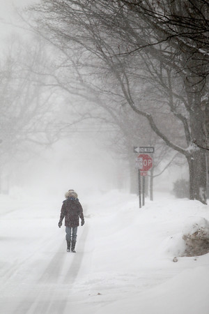 Record-Eagle/Jan-Michael Stump<br /> Karen Anderson walks down Wadsworth Street in Traverse City during Tuesday's snowstorm.
