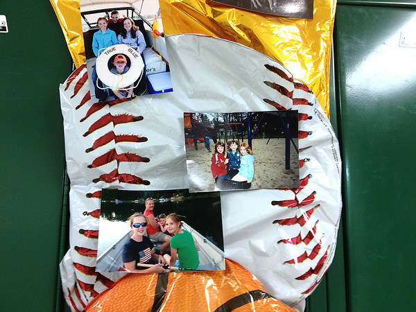 Record-Eagle/Angie Jackson <br /> Friends hung a poster on Christa Pipoly's locker at Kingsley Middle School. The 13-year-old and her father, David, died Sunday after a car crash with a snow plow truck.