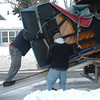 """Record-Eagle photos/Marta Hepler Drahos<br /> Above, Derrick Hall, left, Mat Albert, right, and Dan Watson, top, of Kurtz Movers, ease late pianist Karl Haas' piano down a truck ramp while delivering it to Jeff Haas, Karl's son, Wednesday morning. Karl Haas played the piano on his WJR Radio show, """"Adventures in Good Music,"""" which went on to be syndicated worldwide to over 650 stations and 3.6 million listeners daily during the late 1980s through 2003. Right, Jeff Haas plays the instrument."""