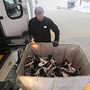 Record-Eagle/Keith King<br /> Gary Noteware, transportation driver at Grand Traverse Resort and Spa in Acme Township, prepares to transport ice skates as preparations are made for the Special Olympics Michigan State Winter Games. Opening ceremonies are scheduled for Wednesday evening.
