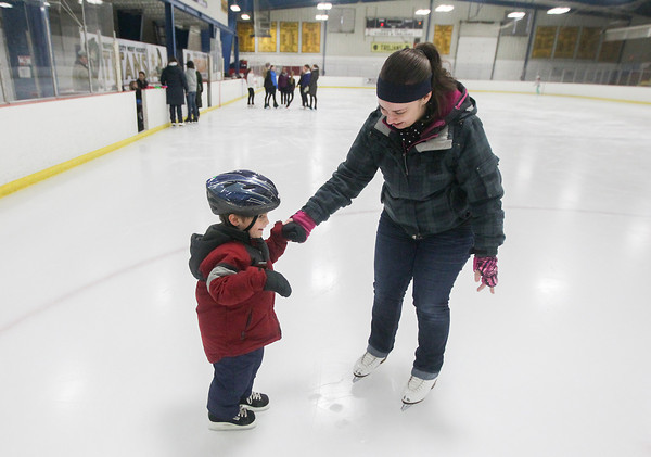 Record-Eagle/Keith King<br /> Braden Grimm, 3, of Rapid City, skates with his aunt, Cassie Grimm, of Traverse City, during an open skate at Howe Arena hosted by the Traverse City Figure Skating Club to celebrate National Skating Month. Free rentals and ice time were offered during the event as well as ice skate tying and fitting tips and basic lessons given by Traverse City Figure Skating Club members and instructors. The event is also scheduled to take place Saturday, February 8.