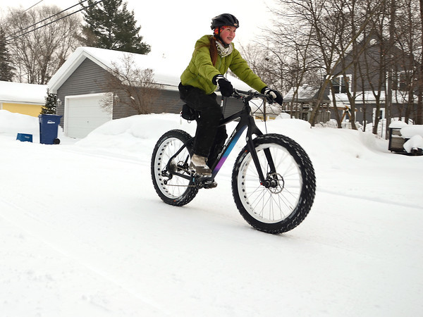 """Record-Eagle/Allison Batdorff<br /> Maya Howard of Traverse City likes to ride the family fat bike in the wintertime. """"It's fun to be able to ride a ride on the snow,"""" Howard, 12, said."""