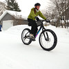 "Record-Eagle/Allison Batdorff<br /> Maya Howard of Traverse City likes to ride the family fat bike in the wintertime. ""It's fun to be able to ride a ride on the snow,"" Howard, 12, said."