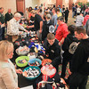 Record-Eagle/Keith King<br /> Teams gather as volunteers assist at a souvenir table Tuesday after teams arrived to the Grand Traverse Resort and Spa in Acme Township for the Special Olympics Michigan State Winter Games.