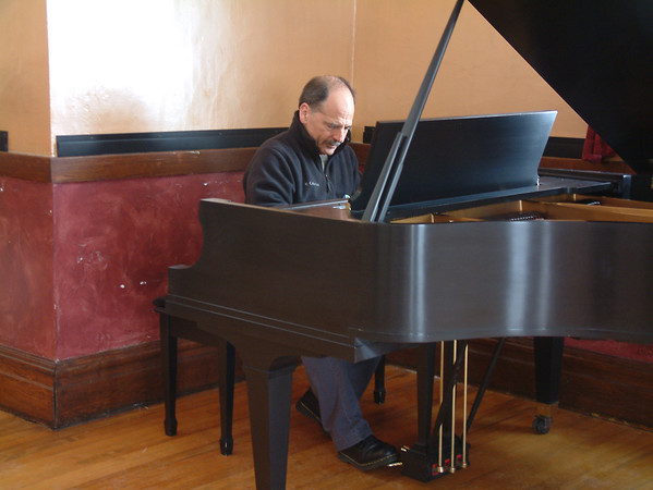 """Record-Eagle/Marta Hepler Drahos<br /> Pianist Jeff Haas plays a piano that belonged to his late father, classical pianist Karl Haas, after it was delivered to him Wednesday morning. Karl Haas played the piano on his WJR Radio show, """"Adventures in Good Music,"""" which went on to be syndicated worldwide to more than 650 stations and 3.6 million listeners daily during the late 1980s through 2003."""