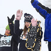 Record-Eagle/Keith King<br /> Gracie Simon (1030), from left, Audrey Kurtz (1023) and Kira Thatcher (1182) raise their arms after athletes were awarded medals and ribbons after competing in a 30-meter snowshoe race Thursday at the Grand Traverse Resort and Spa in Acme Township during the Special Olympics Michigan State Winter Games.