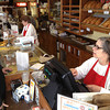 Record-Eagle/Nathan Payne<br /> Linda Carrell and Fannie Wyckoff tend to customers Wednesday morning in the Eighth Street location of Potter's Bakery. The women have become accustomed to the bakery's regular customers many of whom have made daily trips to the counter for decades.