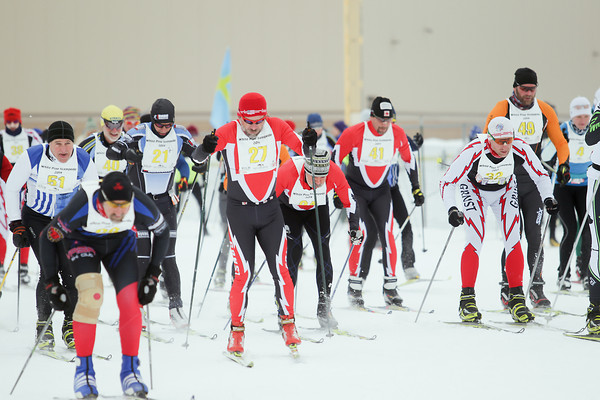 Record-Eagle/Keith King<br /> Cross-country skiers take off from the starting line at Mancelona High School at the start of the White Pine Stampede 50K race.