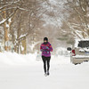 """Record-Eagle/Keith King<br /> Kym Hansen-Duell, of Traverse City, jogs in Traverse City as she trains for a half marathon. """"All the snow,"""" Hansen-Duell says is a challenge as she trains. """"I'm doing hurdles in the deep snow,"""" Hansen-Duell said."""