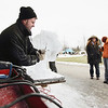 Record-Eagle/Keith King<br /> Derek Maxfield, of Grand Rapids, with the Food Network's 'Ice Brigade,' carves a tiger out of ice Saturday at the Grand Traverse Resort & Spa in Acme.