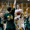 Record-Eagle/Jan-Michael Stump<br /> Traverse City Central's Dylan Roe (30) drives the lane Friday.