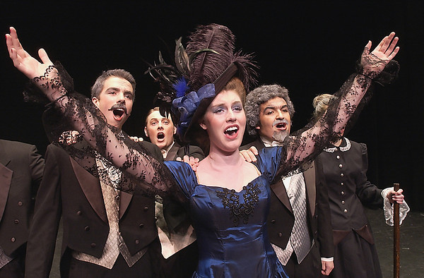 Record-Eagle/Garret Leiva<br /> Patrick Kiessling, as Firmin; Jeff Stout, as Raoul; and Zeky Nadji, as Andre, insist that Kaitlyn Pettinato, as Carlotta, is their leading lady.