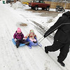 "Record-Eagle/Keith King<br /> Michele Cepela, of Leelanau County, pulls Riley Burkholder, left, 2, of Traverse City, and her sister, Harper Burkholder, 10 months, Wednesday, February 23, 2011 in a Traverse City alley. ""They wanted to use the sleds today and the sidewalks are pretty clear so we decided to go here,"" Michele, who was babysitting the girls, said."