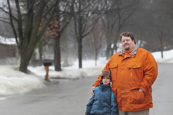 Record-Eagle/Keith King <br /> Tres Brooke and his son, Quaid Brooke, of Traverse City, stand in their neighborhood.