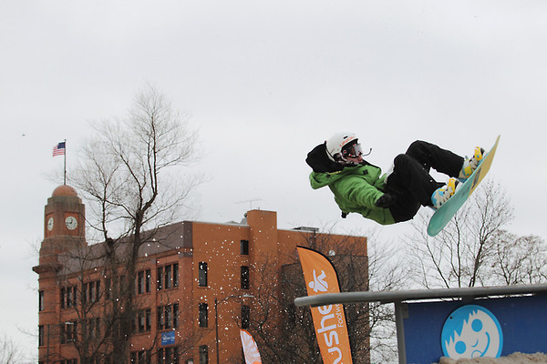 Record-Eagle/Keith King<br /> Geordon Carter, 14, of Traverse City, competes in the EpicHappens 'Downtown Throwdown Rail Jam' Saturday, during the Cherry Capital Winter Wowfest.