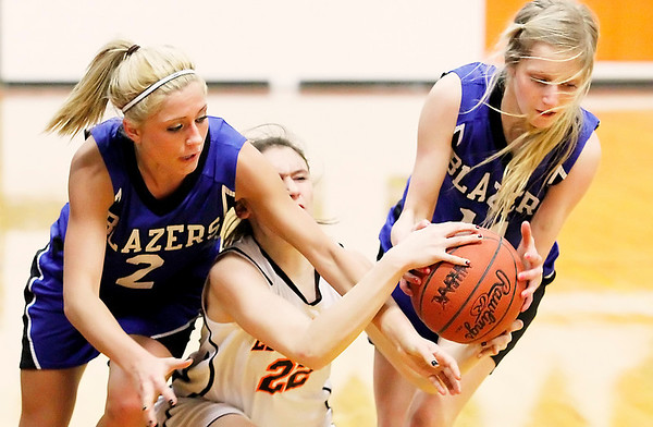 Record-Eagle/Jan-Michael Stump<br /> Kalkaska's Chelsea Matley (2) and Karli Hauser (11) strip the ball from Elk Rapids' Ryleigh Abbas (22) in the third quarter of Tuesday's game.