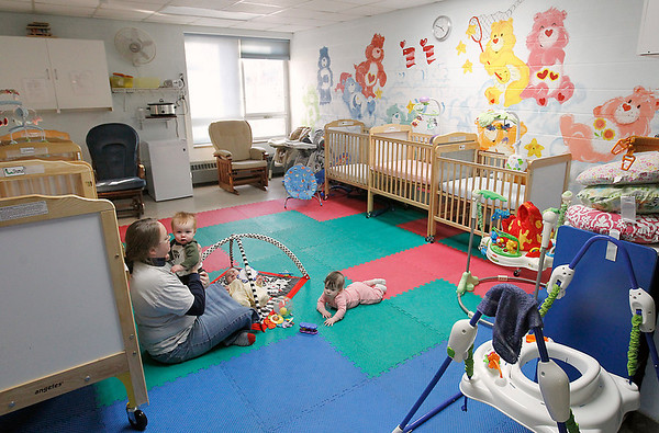 Record-Eagle/Jan-Michael Stump<br /> Assistant caregiver Esther Destouet plays with infants at the daycare at Central United Methodist Church.