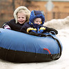 Record-Eagle/Keith King<br /> Paige Bell, left, 5, of Traverse City, and her twin brother, Michael Bell, careen downa  slope on a snow tube Saturday.