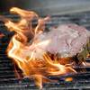 Record-Eagle/Jan-Michael Stump<br /> John Larbarbera cooks steaks on the grill in the kitchen at Mode's Bum Steer on Wednesday. The restaurant is offering a number of specials, including ribs, prime rib, lettuce wedge and bananas foster as specials during restaurant week.
