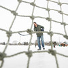 "Record-Eagle/Keith King<br /> Alex Redmond, of Traverse City, shoots a puck at the ice rink on Fourteenth Street in Traverse City. ""It's my day off and I just wanted to get out and take advantage of the ice while I still have a chance to,"" Redmond said."