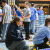 Record-Eagle/Keith King<br /> Teams build sculptures with cans of food at the Grand Traverse Mall Saturday during the third annual Canstruction-TC event to benefit The Father Fred Foundation's food pantry. More than 29,000 cans of food will be used by 18 teams during the event with the food being donated to the Father Fred Foundation after the sculptures are displayed at the mall through March 1.