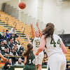 Record-Eagle/Keith King<br /> Traverse City West's Kimmy Bilinski (23) shoots the ball against Alpena Friday during the Class A district championship game at Traverse City West High School.
