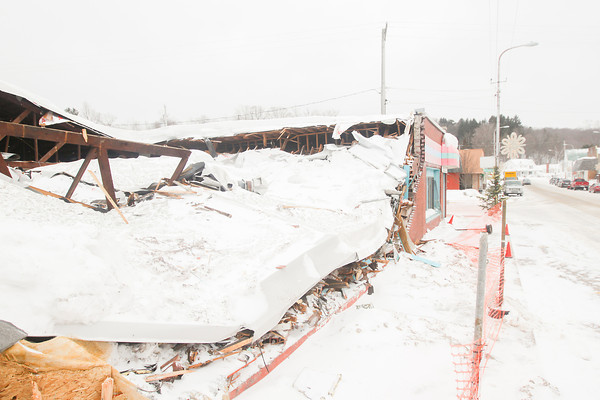 Record-Eagle/Keith King<br /> A roof which collapsed under several feet of snow is visible at a long-vacant bowling alley on Benzie Boulevard in Beulah.