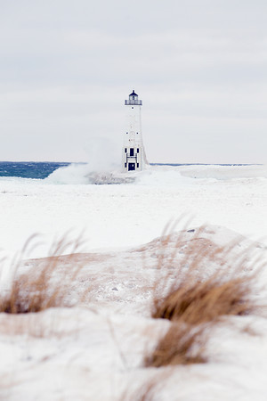 Record-Eagle/Keith King<br /> Waves from Lake Michigan crash against the Frankfort North Breakwater Lighthouse on a winter day.
