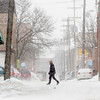 Record-Eagle/Keith King<br /> A pedestrian walks along Union Street through blowing snow Friday in downtown Traverse City.