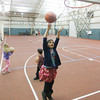 Record-Eagle/Keith King<br /> Ava Whinnery shoots a basketball during School's Out Fun Club at the Grand Traverse Bay YMCA on Racquet Club Drive in Traverse City.