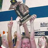 Record-Eagle/Chris Dobrowolski <br /> Bellaire senior guard Madalyn Balon lifts the district championship trophy after the Eagles defeated Gaylord St. Mary 44-32 on Friday at Central Lake high School.