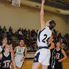 Record-Eagle file photo/James Cook<br /> TC St. Francis' Julianna Phillips (24) goes up for a bucket as teammate Lydia Arthur (10) looks on.