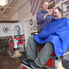 Record-Eagle/Michael Walton<br /> Larry Olson, owner of Trimmer's Barbershop, cuts Joe Paternoster's hair inside his shop located in downtown Kalkaska. Both love this winter's cold and snowy weather, and Olson said it's been a popular topic of conversation among patrons at his shop.