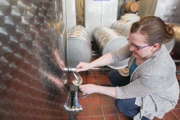 Record-Eagle/Keith King<br /> Meridith Lauzon, operations manager, draws a sample of 2013 Pinot blanc wine Friday at Left Food Charley in Traverse City.