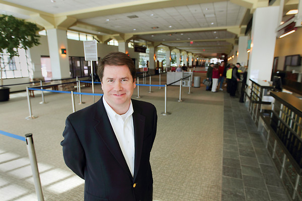 Record-Eagle/Keith King<br /> <br /> Kevin Klein, Cherry Capital Airport director, stands Thursday, March 24, 2011 near the airline ticket counters.